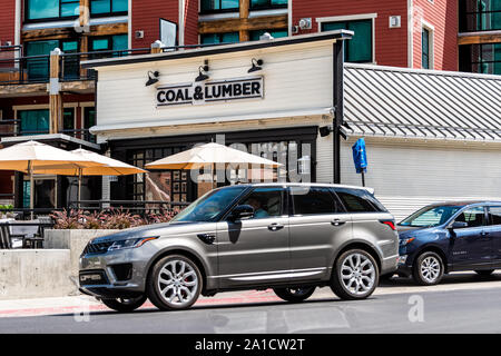 Park City, USA - July 25, 2019: Ski resort famous town street in Utah during summer with restaurant coal and lumber sign in downtown building - Stock Photo
