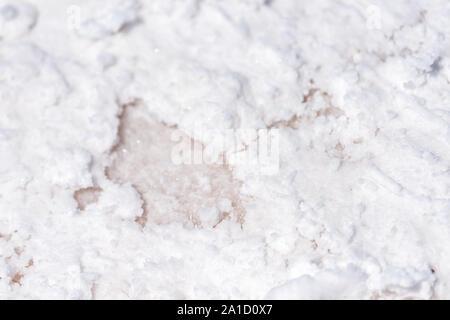 Macro closeup view on white texture of Bonneville salt flats with wet salt on ground abstract - Stock Photo