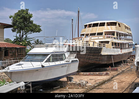 Thailand boat repair yard with vessels undergoing renovation. Southeast Asia - Stock Photo