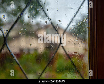 Blurred landscape outside the window, on the glass raindrops.  - Stock Photo
