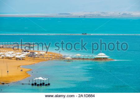 Israel, South District, Ein Bokek. Beach on the Dead Sea coast in the resort town of En Bokek, elevated view. - Stock Photo