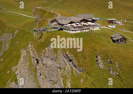 Aerial view of First Mountain Restaurant with Tissot First Cliff Walk lookout platform above Grindelwald in the Bernese Alps, Switzerland. - Stock Photo