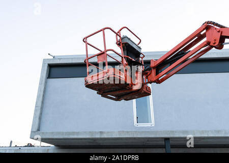 Telescopic elevator on construction site. Construction equipment - Stock Photo