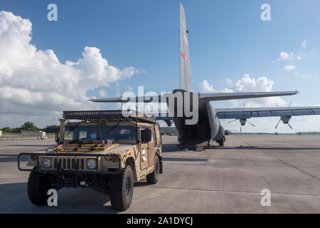 A U.S. Air Force Humvee is prepped to be loaded onto a C-130J Super Hercules, at Homestead Air Reserve Base, Fla., Sept. 11, 2019, to support a site survey mission in The Bahamas. U.S. Northern Command provided military-unique capabilities to the U.S. Agency for International Development, enabling the broader relief efforts addressing the acute humanitarian needs of the Bahamian people.  (U.S. Air Force photo by Tech. Sgt. Joshua J. Garcia) - Stock Photo