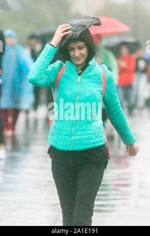 London, United Kingdom - 26 September 2019. A Pedestrian braves the heavy rain showers on Westminster Bridge. Credit: amer ghazzal/Alamy Live News - Stock Photo