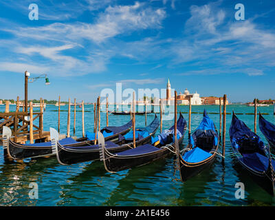 Gondolas and in lagoon of Venice by Saint Mark San Marco square