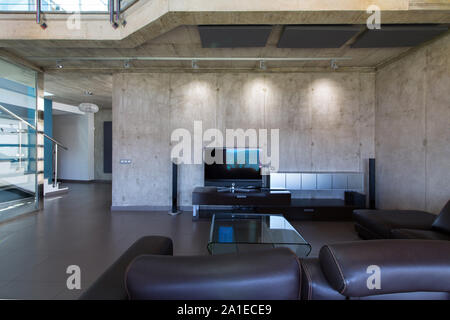 Living room in interior of modern concrete house. - Stock Photo