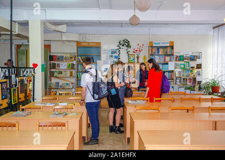 Chapaevsk, Samara region, Russia - April 16, 2019: College in Chapaevsk city. Students at break in class with teacher - Stock Photo
