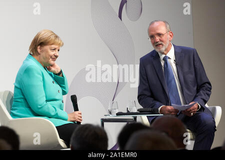 Hessen, Germany.  26 September 2019, Hessen, Frankfurt/M.: Federal Chancellor Angela Merkel (CDU) speaks at the 70th anniversary congress of the Frankfurter Allgemeine Zeitung with publisher Berthold Kohler. 30 lectures from the departments of politics, economy, sports, arts pages, Rhine-Main and 'FAZ.NET' are planned. Photo: Thomas Frey/dpa Credit: dpa picture alliance/Alamy Live News - Stock Photo