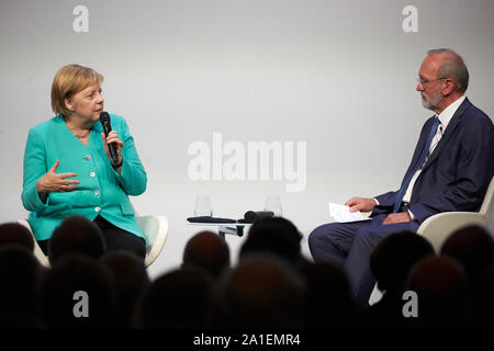 Hessen, Germany.  26 September 2019, Hessen, Frankfurt/M.: Federal Chancellor Angela Merkel (CDU) speaks at the congress to mark the 70th anniversary of the Frankfurter Allgemeine Zeitung with publisher Berthold Kohler. 30 lectures from the departments of politics, economy, sports, arts pages, Rhine-Main and 'FAZ.NET' are planned. Photo: Thomas Frey/dpa Credit: dpa picture alliance/Alamy Live News - Stock Photo