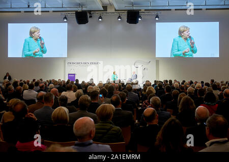 Hessen, Germany.  26 September 2019, Hessen, Frankfurt/Main: Federal Chancellor Angela Merkel (CDU) speaks at the congress to mark the 70th anniversary of the Frankfurter Allgemeine Zeitung with publisher Berthold Kohler. 30 lectures from the departments of politics, economy, sports, arts pages, Rhine-Main and 'FAZ.NET' are planned. Photo: Thomas Frey/dpa Credit: dpa picture alliance/Alamy Live News - Stock Photo