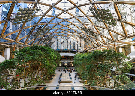 Interior view, courtyard and glass structure roof of Portcullis House by Hopkins Architects, part of the Parliamentary Estate in Westminster, London, - Stock Photo