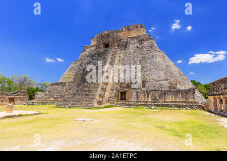 Uxmal, Mexico. Pyramid of the Magician in ancient Mayan city. - Stock Photo