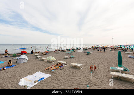 JULY 22, 2019 - GRADO, ITALY - Bathing beach of the upper Adriatic sea at Grado, Northeastern Italy - Stock Photo