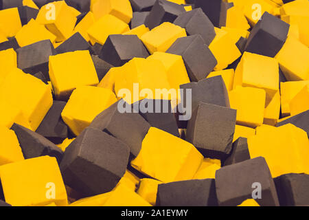 Multicolored foam cubes on the playground in the trampoline center. - Stock Photo
