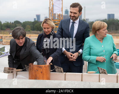 26 September 2019, Hessen, Frankfurt/Main: Federal coach Joachim Löw (l-r), DFB trainer Martina Voss-Tecklenburg, Friedrich Curtius, DFB Secretary General and Federal Chancellor Agela Merkel (CDU) jointly equip a time capsule at the laying of the foundation stone of the DFB Academy. Photo: Boris Roessler/dpa - Stock Photo