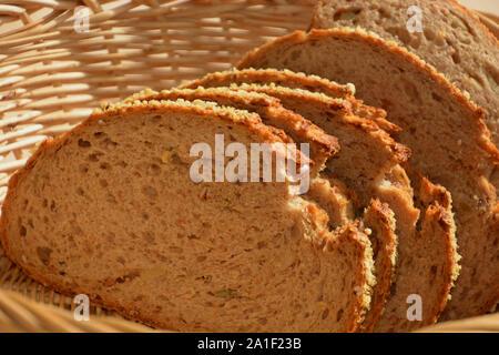 emmer loaf, slices of emmer wheat bread in breakfast basket - Stock Photo