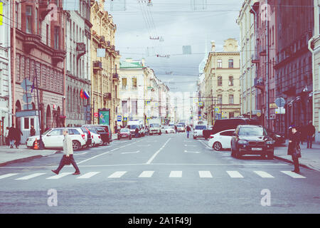 SAINT PETERSBURG, RUSSIA - SEPTEMBER 17, 2019: Street traffic in historic part of city in St.Petersburg, Russia. - Stock Photo
