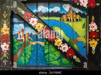 Painted door in Llangollen, Denbighshire, Wales, United Kingdom.  Folk art. - Stock Photo