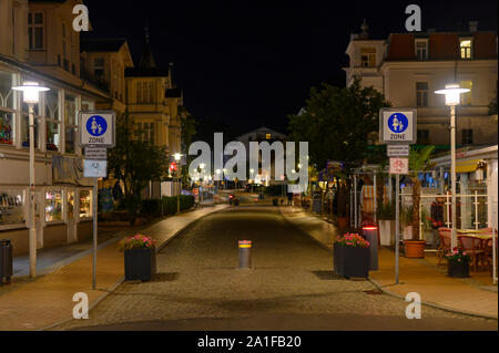 Bansin, Germany - September 13, 2019: Night shot in Bansin, Germany, on the island Usedom. You can see the pedestrian area lit by lanterns. - Stock Photo