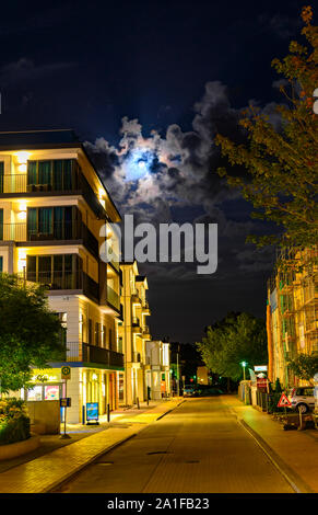 Bansin, Germany - September 13, 2019: Night shot in Bansin, Germany, on the island Usedom. You can see the illuminated facades of the houses and the m - Stock Photo