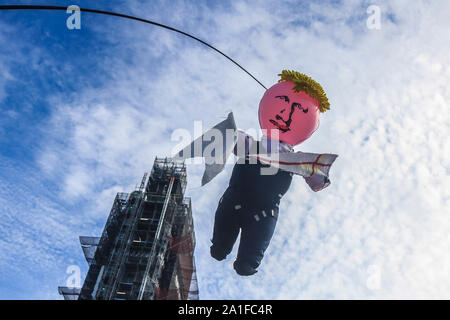 London, United Kingdom - 25 September 2019. An effigy inflatable doll of British Prime Minister Boris Johnson is hung on a pole in front of Parliament by Anti Brexit protesters. Prime Minister Boris Johnson has been criticized by opposition parties for using inflammatory language to describe the No Deal Brexit Bill that  was passed in the House of Commons Credit: amer ghazzal/Alamy Live News - Stock Photo