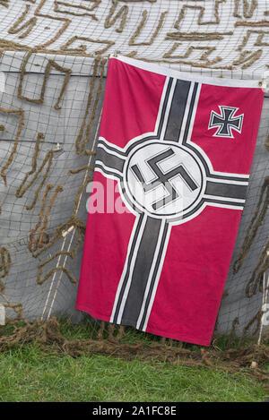 German encampment tent and the 3rd Reich Battle Flag, die Reichskriegsflagge - Stock Photo