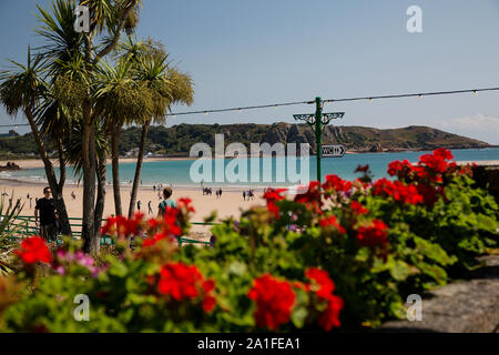 A view of the sea from the colourful Winston Churchill Memorial Gardens at St Brelades, Jersey, Channel Islands - Stock Photo