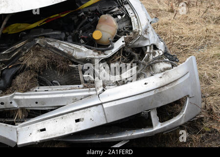 Close up of crushed car after accident. - Stock Photo