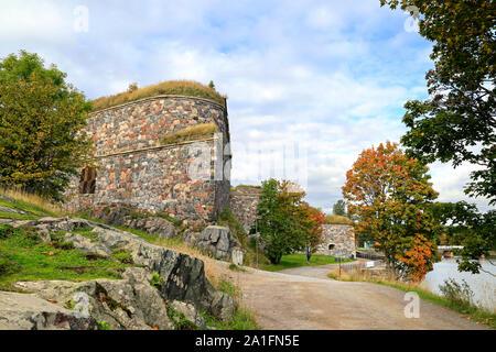 Seaside path in Fortress of Suomenlinna, inhabited sea fortress built on 8 islands near Helsinki, Finland. Suomenlinna is an UNESCO World Heritage sit - Stock Photo