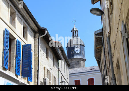 Quaint backstreets and clock tower of the town of Melle in the region of Deux Sevres in western France. - Stock Photo