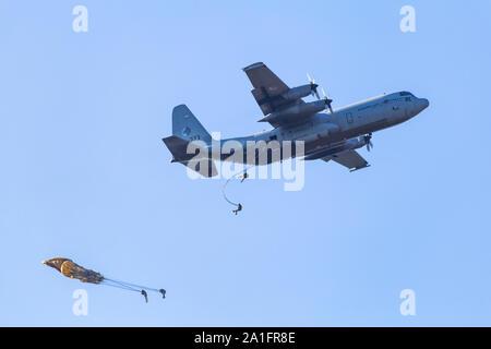 Ede, Netherlands, September 21, 2019: Dutch Airforce plane dropping paratroopers memorial Operation Market Garden WOII Arnhem in the Netherlands. - Stock Photo