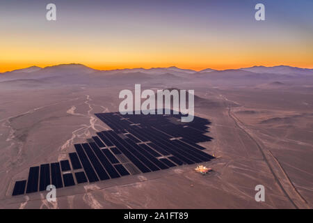 Aerial view of Solar Energy Photovoltaic Power Plant over Atacama desert sands, Chile. Sustainability and green energy from the sun with Solar Energy