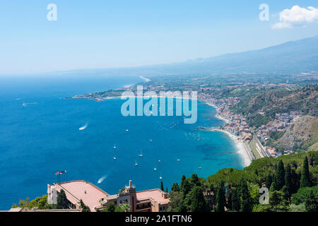 Aerial view of Giardini Naxos from Taormina city with Etna volcano on background. Thi island of Sicily, Italy.