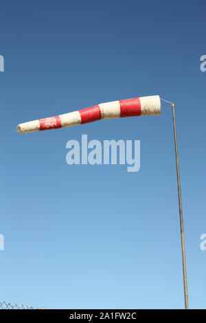 Windsock. Instrument for measuring wind speed and direction. - Stock Photo