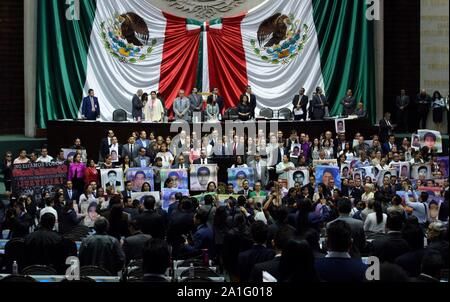 Mexico City, Mexico. 26th Sep, 2019. Relatives and support groups of the 43 Ayotzinapa's students, missing 5 years ago, demonstrate at the Deputy Chamber in Mexico City, Mexico, 26 September 2019. The case of the 43 Ayotzinapa's students continue being the more emblematic of the disappearances in Mexico 5 years later, without the existence of certainty about the destination of the students while the relatives ask for an answer of the government. Credit: EFE News Agency/Alamy Live News - Stock Photo