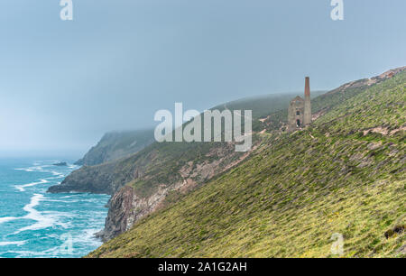 Stunning coastal scenery at Chapel Porth with Wheal Coates Tin mine seen through the mist. Cornwall, England. UK. - Stock Photo