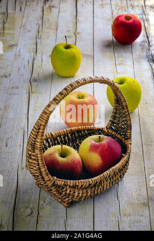 organic red apples in a wicker basket Stock Photo