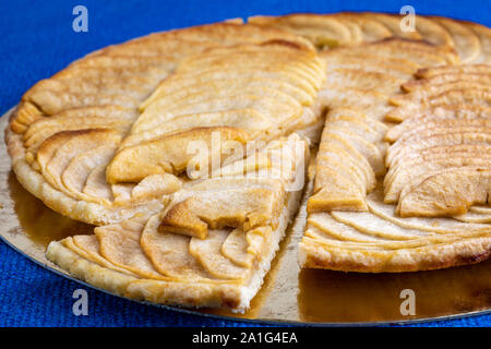 Organic apple pie dessert on a rustic blue cloth tablecloth - Stock Photo