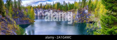 Magnificent natural landscape with marble rocks, a green lake and autumn forest in Ruskeala near Sortavala, Karelia, Russia - Stock Photo