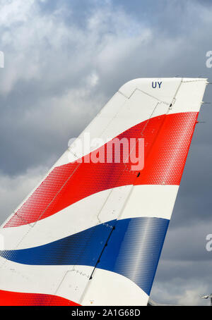 LONDON HEATHROW AIRPORT - MARCH 2019: Close up view of the tail fin of a British Airways jet at London Heathrow Airport. - Stock Photo