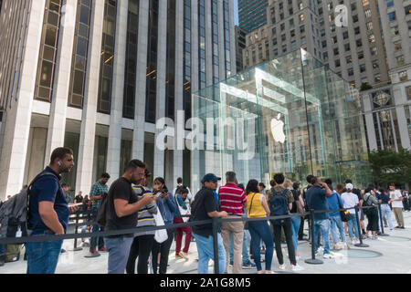 Apple Computer Store, Fifth  Avenue,  People in Line to purchase Latest iPhone Model, NYC - Stock Photo