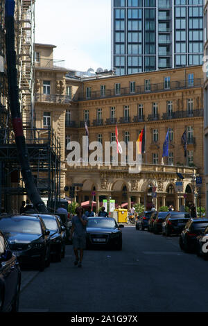 Frankfurt, Germany - July 06, 2019: The Imperial Square in the city center with the Hotel Steigenberger Frankfurter Hof as well as shops and commercia - Stock Photo