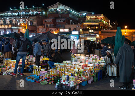 famous Jemaa-el-Fna market place the evening in Marrakech in Morocco - Stock Photo