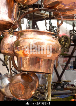 Selling antique copper kitchen utensils. San Telmo market in Buenos Aires, Argentina. - Stock Photo