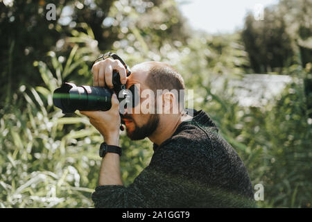 nature photographer taking a photograph - Stock Photo