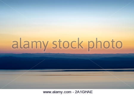 Jordan, Madaba Governorate, near Ma'in. Dead sea and view of mountains in Israel at sunset. - Stock Photo
