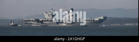 HMS Prince of Wales anchored off Rosyth preparing to depart for sea trials. - Stock Photo
