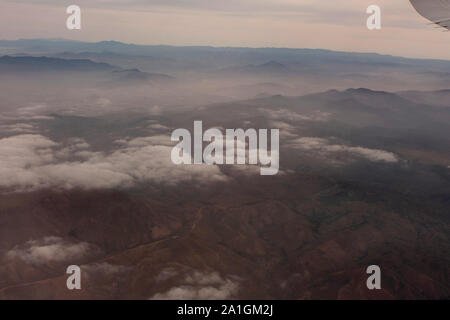 Landscape Aerial shot of mountain chain clouds and Mexican land approaching Tijuana Mexico - Stock Photo