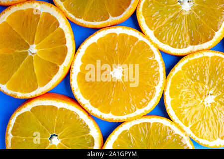 Several orange slides close to each other on a blue background - Stock Photo